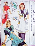 1940s Pretty Orange Blossom Apron and Pot Holders Pattern McCall 1377 Flirty Ruffle Style Full Bib Apron with Applique Transfer Vintage Sewing Pattern